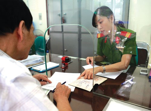 A man registers to obtain ho khau at a police station in Vietnam