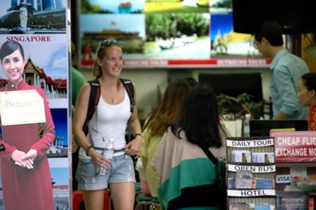 A foreign tourist leaves a travel agency in the backpackers' area in Ho Chi Minh City. Photo: Tuan Anh