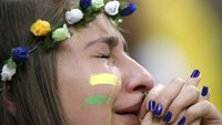 A Brazil fan reacts after the 2014 World Cup third-place playoff between Brazil and the Netherlands at the Brasilia national stadium in Brasilia July 12, 2014. Photo: Reuters