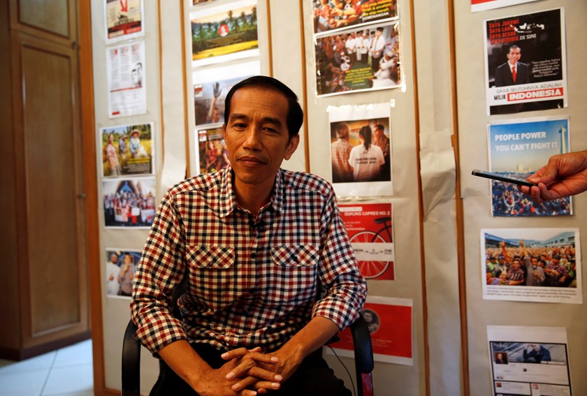 "Indonesia presidential candidate Joko ""Jokowi"" Widodo listens to a question during an interview with Reuters in Jakarta July 10, 2014. Photo credit: Reuters"