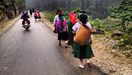 H'Mong families walk to the Sunday market at the King's Palace in Sa Phin. Photo: Olof
