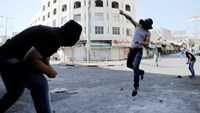 A Palestinian protester hurls a stone at Israeli troops following a demonstration against Israeli military action in Gaza, in the West Bank City of Hebron August 15, 2014. Photo: Reuters