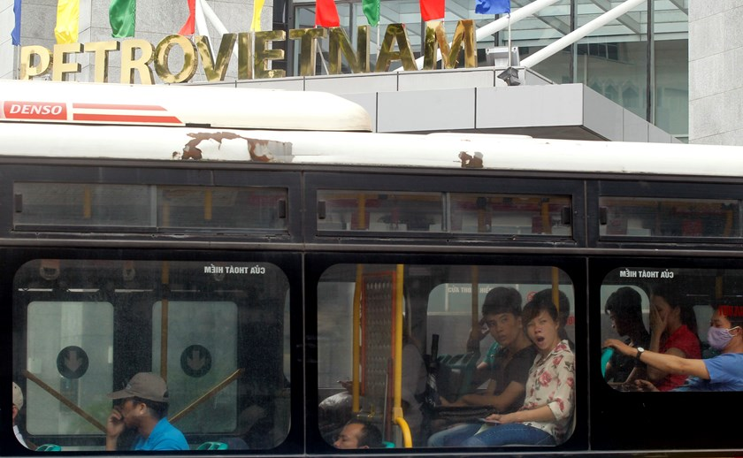 A bus goes past PetroVietnam's headquarters in Hanoi. The state still holds 97 percent of PetroVietnam Gas, a PetroVietnam unit. Investors are deterred by the size of the stakes being retained by the government, an analyst says. Photo: Reuters