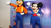 Performers dressed as Mickey Mouse and Goofy will perform illusions alongside other Disney characters in Ho Chi Minh City at the end of September. Photo credit: VietJet Air