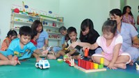 Children play with toys at the new toy library in Tam Binh orphanage,  Ho Chi Minh City on September 18, 2014. Photo: Thao Vi