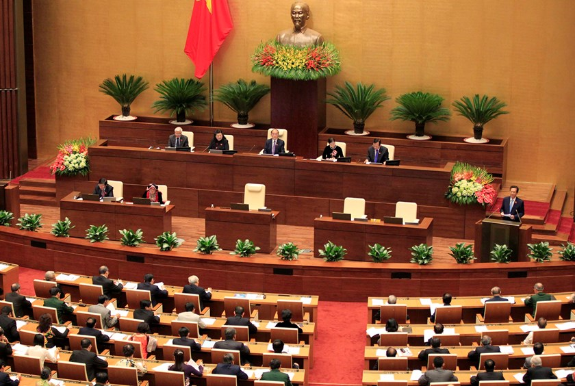 Vietnam's Prime Minister Nguyen Tan Dung (R, bottom, on stage) speaks at the opening ceremony of the National Assembly's 2014 autumn session at the new Ba Dinh hall in Hanoi October 20, 2014. Photo: Reuters