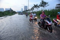 Nguyen Huu Tho Street in Ho Chi Minh City's District 7 was flooded during high tides early this month. Photo: Diep Duc Minh