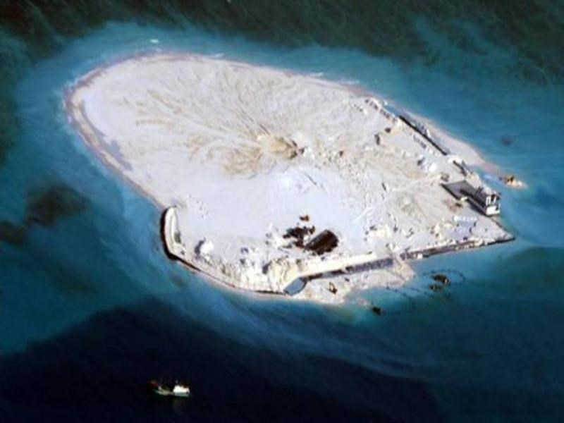 A Philippine surveillance photo taken in February of the Johnson South Reef in the South China Sea appears to show a large-scale reclamation effort being carried out by China. Photo via Reuters