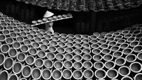 """Traditional"" by photographer Tran Dinh Thuong depicts a woman transporting ceramic pots at a kiln"