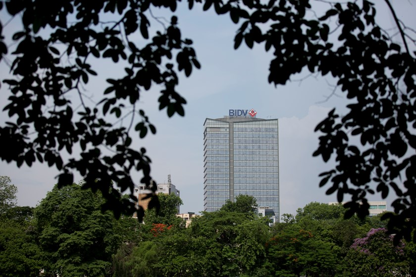 The Joint Stock Commercial Bank for Investment and Development of Vietnam (BIDV) building stands in Hanoi. Moody's revised the outlook on Vietnam's banking system to stable from a negative assessment. Photo credit: Bloomberg