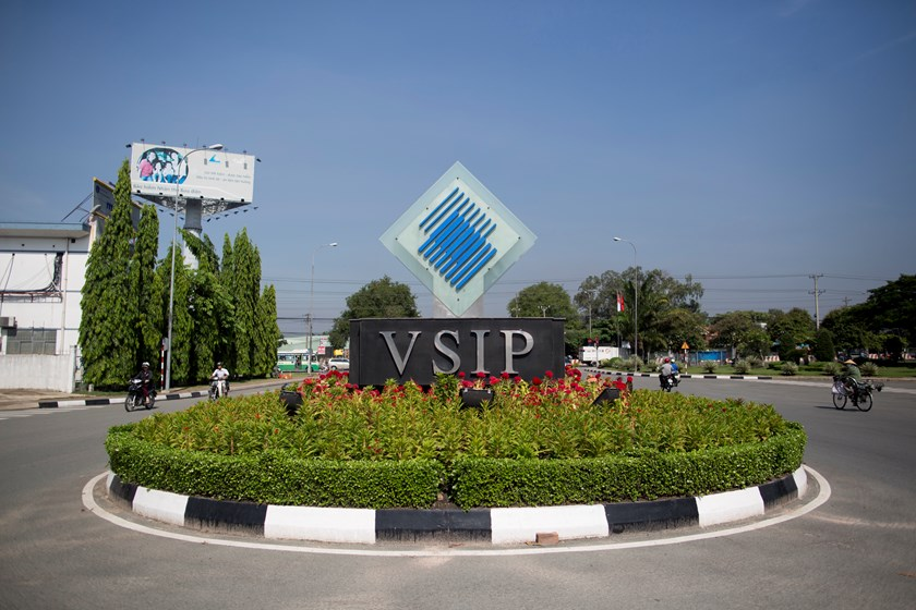 Signage for the Vietnam-Singapore Industrial Park stands in Thuan An, Binh Duong Province. Photo credit: Bloomberg