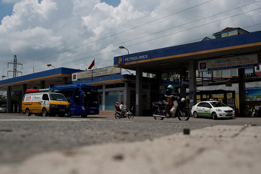Traffic drives past a Petrolimex gas station in Hanoi. Photo credit: Bloomberg