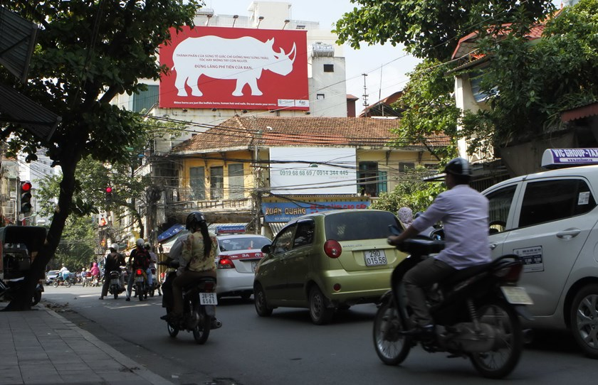 "A poster, seen on a street in Hanoi, reads, ""Rhino horns are just like buffalo horns, human hair and nails. Do not waste your money.""  Photo credit: Reuters"