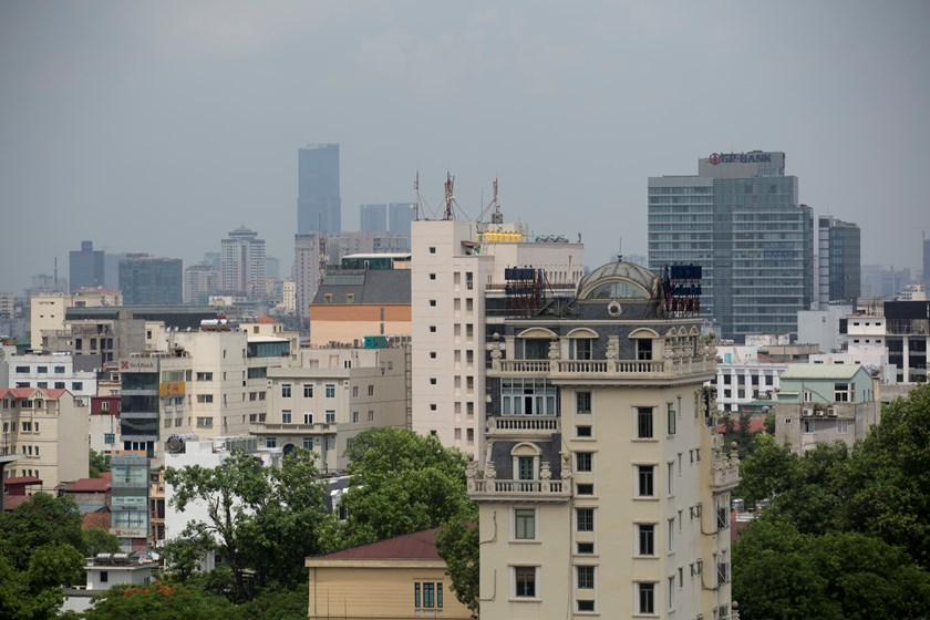Commercial and residential buildings stand in Hanoi. Photo credit: Bloomberg