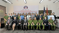 Asian police and officials pose for a photo at the opening ceremony of the 37th Asia Region Law Enforcement Management Program in Ho Chi Minh City on April 7, 2015. Photo supplied