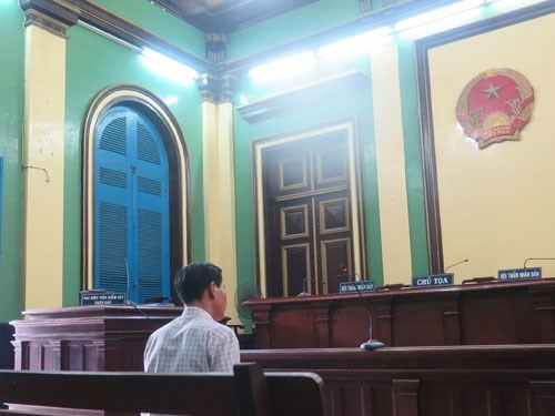 Le Thanh Nghi, a former lieutenant with police division in Hiep Binh Phuoc Ward of Thu Duc District, was convicted of abusing his powers. Photo:  Phan Thuong