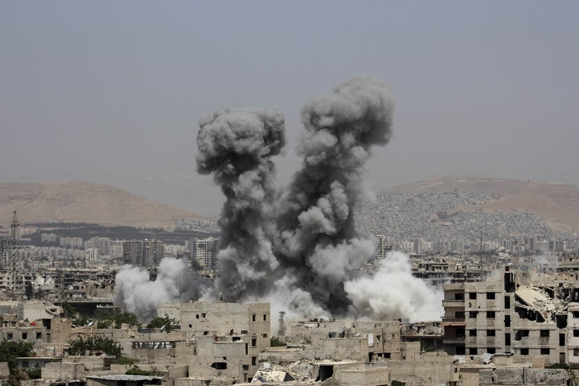 Smoke billows following air strikes by regime forces in the rebel-held area of Ain Tarma, east of the capital Damascus, on April 29, 2015. Photo: AFP