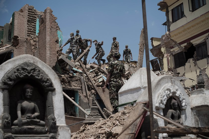 This picture taken on May 2, 2015, shows Nepalese soldiers clearing rubble of a building at the damaged Swayambhunath temple in Kathmandu, following a 7.8 magnitude earthquake which struck the Himalayan nation on April 25. Photo: AFP