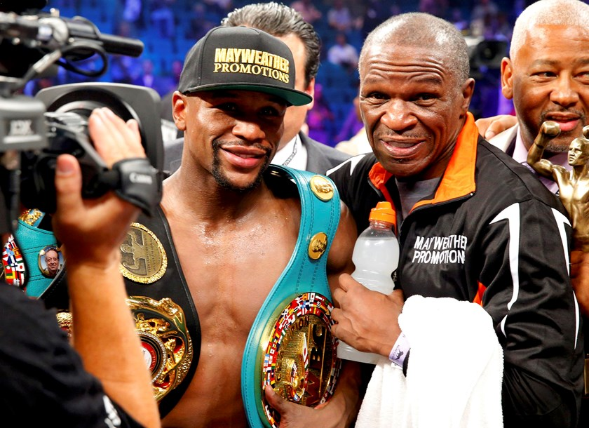 Floyd Mayweather, Jr. of the U.S. and his trainer Rafael Garcia (R) pose for a picture after Mayweather defeated Manny Pacquiao of the Philippines in their welterweight WBO, WBC and WBA (Super) title fight in Las Vegas, Nevada, May 2, 2015. Photo: Reuters