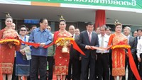 Vietnamese President Truong Tan Sang (front, second from right) and his Lao counterpart Choummaly Sayasone (second from left) join the ribbon cutting ceremony to mark Attapeu International Airport's opening in Attapeu, Laos on May 30, 2015. Photo: N.Son
