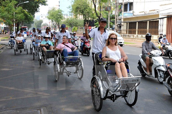 Foreign visitors take a cyclo tour in Ho Chi Minh City. Photo: Vietnam News Agency