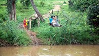 In central Vietnam commune, people use rickety cable car to cross stream