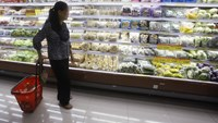 A woman shops at a supermarket in Hanoi. Photo: Reuters