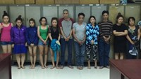 The gang of 13 members at a police station in Ho Chi Minh City. Photo: Ngoc Tho
