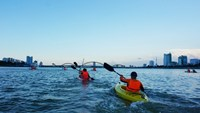 Tourists enjoy a kayak tour on the Han River in Da Nang City. Photo: An Dy