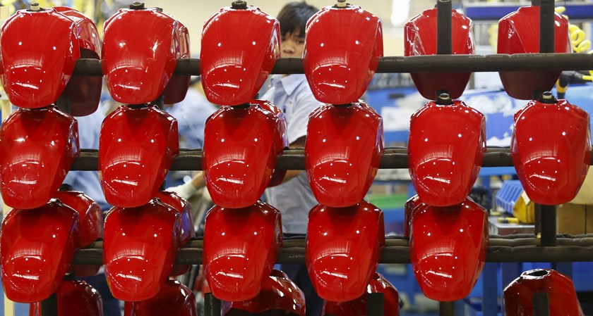 A man works at a Piaggio scooter and motorcycle factory in Vietnam's northern Vinh Phuc province, outside Hanoi on April 21, 2015. Photo: Kham/Reuters
