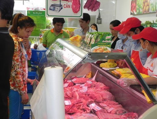 Customers shop for fresh meat at a Vissan store in Ho Chi Minh City. Photo: Hoang Viet