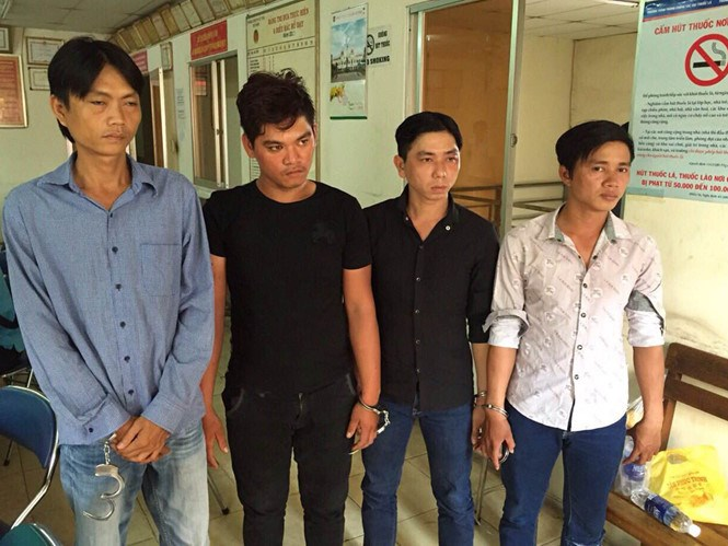 Four alleged members of a gang that has been involved in several crash-and-rob cases in Ho Chi Minh City. Photo: Nguyen Bao