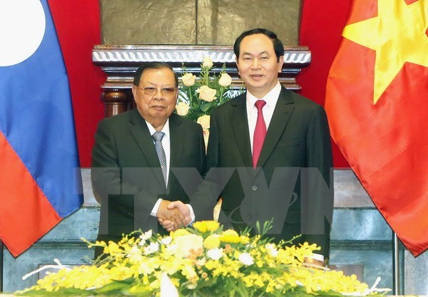 Vietnamese President Tran Dai Quang (R) and Party General Secretary and President of Laos Bounnhang Vorachith. Photo credit: VNA