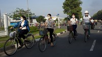Workers ride bicycles to work at an industrial park in Vietnam's southern province of Binh Duong on June 3, 2014. Photo credit: Brent Lewin/Bloomberg
