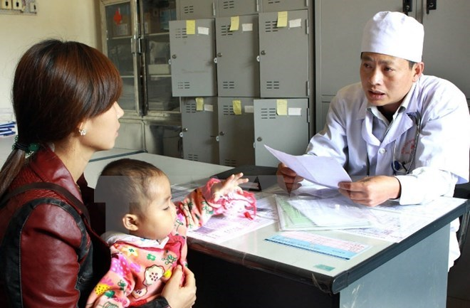 A file photo shows a woman receiving HIV treatment consultancy in the northern province of Son La. Photo: VietnamPlus