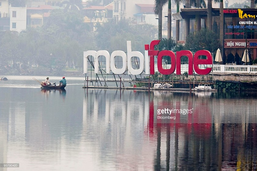 Fisherman on Truc Bach Lake sail near a MobiFone sign in Hanoi in a file photo. Photo credit: Jeff Holt/Bloomberg