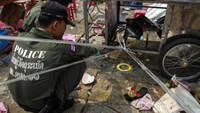 Blood, sandals on street as bomb kills two, wounds 22 in Thai capital