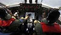 Search planes checking China satellite report on missing airliner