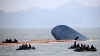Divers at blue bow of Korean ferry stymied by encroaching cold