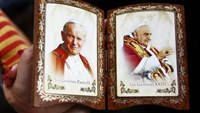 Faithful watch two popes become saints