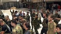 Rebels evacuated from Homs, the cradle of Syrian uprising