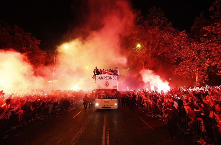 Real Madrid players parade on a bus to celebrate their victory in the UEFA Champions League Final match against Atletico de Madrid at Cibeles Square, Madrid, on May 25, 2014.