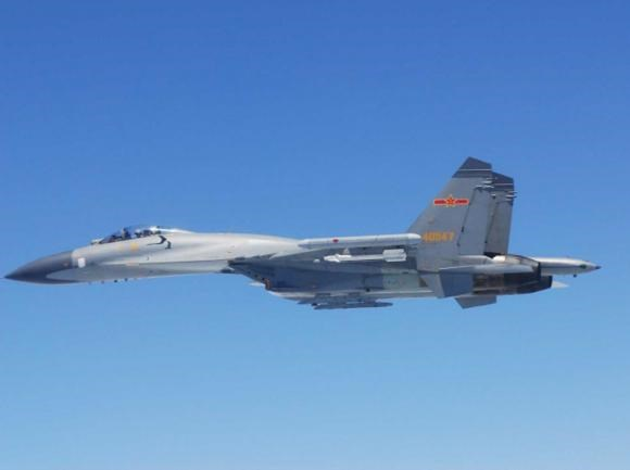 A Chinese SU-27 fighter flies over the East China Sea, in this handout photo taken May 24, 2014 and released by the Defense Ministry of Japan May 25, 2014.