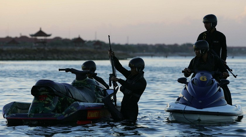 Indonesian navy commandos guard a beach in Nusa Dua, Bali, Indonesia during an economic summit.