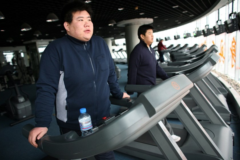 Patients at the Aimin Fat Reduction Hospital exercise on treadmills at the hostpital's gym in Tianjin, China.