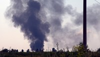 Black smoke rises from a shot down Ukrainian Army helicopter outside Slovyansk, Ukraine, on May 29, 2014.