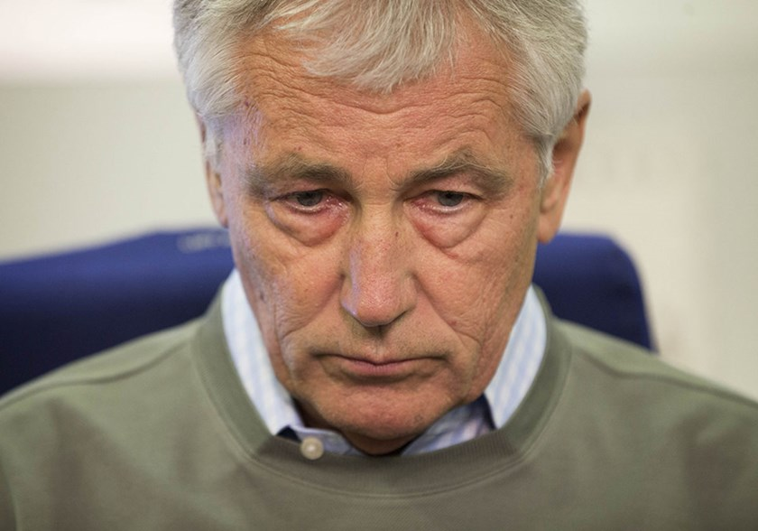 Defense Secretary Chuck Hagel pauses before answering a question from a member of the media during his flight over Canada enroute to Joint Base Elmendorf-Richardson. Photograph: Pablo Martinez Monsivais, Pool via AP Photo