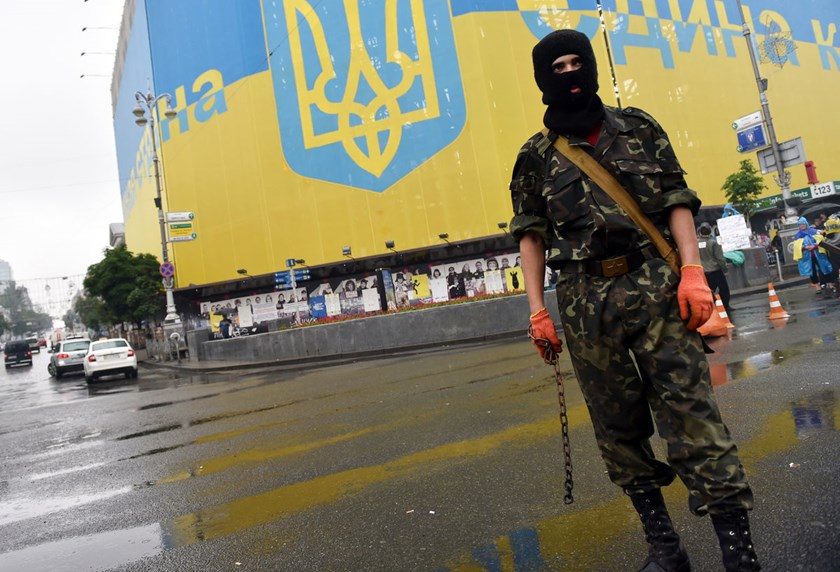 A protester in Kiev's Independence Square protects barricades from being dismantled by communal services, on May 31, 2014.