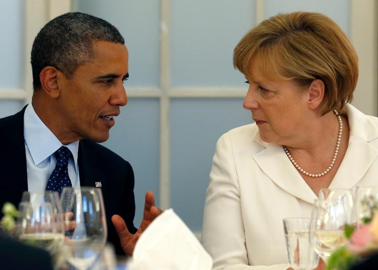 File picture shows US President Barack Obama (L) and German Chancellor Angela Merkel chatting