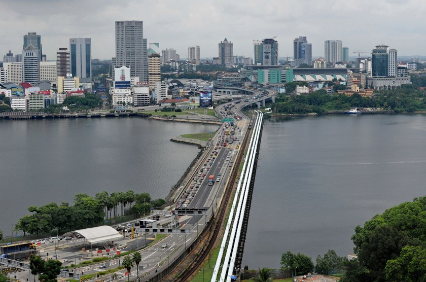 A view of the causeway bordering Malaysia's southern state of Johor Bahru, background, and Singapore, foreground. Photo credit: AFP